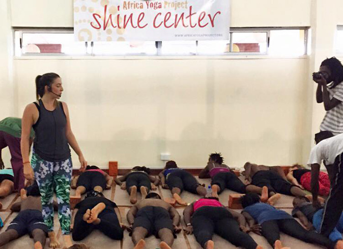Renee running a class at The Africa Project - Light Space Yoga
